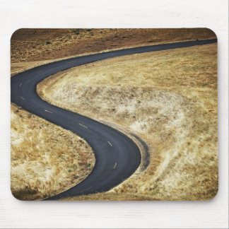 Empty winding paved road mouse pad