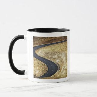Empty winding paved road mug
