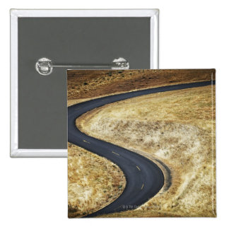 Empty winding paved road pinback button