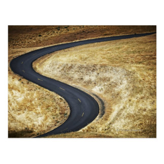 Empty winding paved road postcard