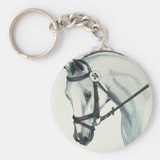 En el caballo BLANCO del Dressage del contacto Llaveros