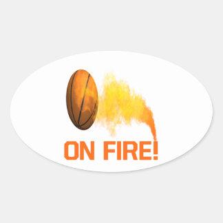 En el fuego pegatina ovalada
