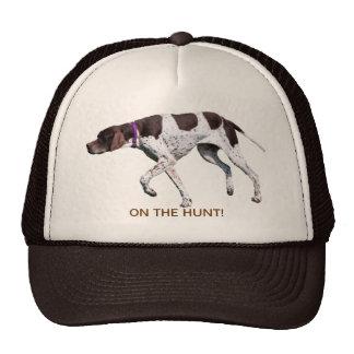 En el gorra inglés del perro del indicador de la c