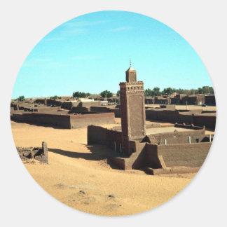 En el oasis de Salah, el más caliente del Sáhara, Etiqueta Redonda