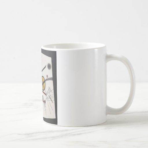 En la casilla negra taza