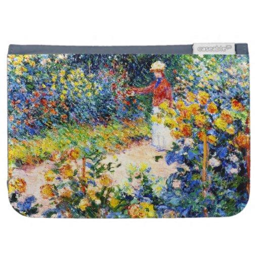 En la pintura de la mujer de Claude Monet del jard