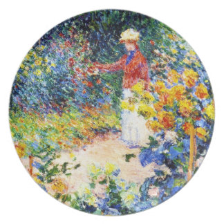 En la pintura de la mujer de Claude Monet del jard Plato De Cena