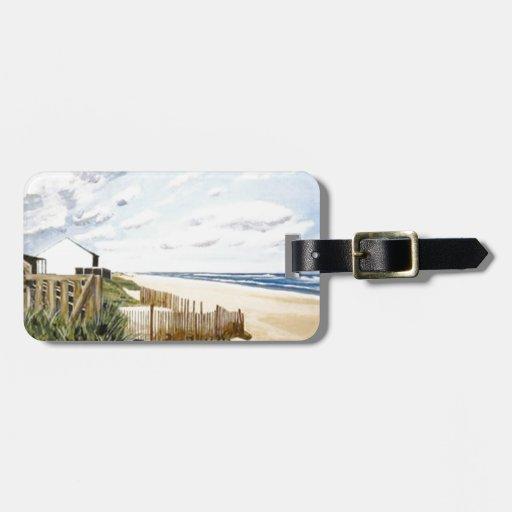 En la playa etiquetas de equipaje