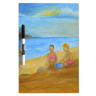 en la playa tablero blanco
