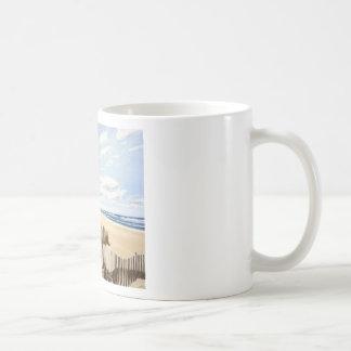En la playa taza