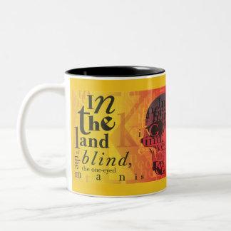 En la tierra del ciego… taza de café de dos colores
