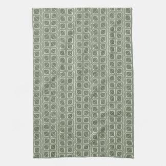 En la toalla de cocina verde de las hojas de mader