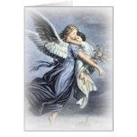 En los brazos de una tarjeta del ángel