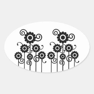 En los pegatinas ovales florales del prado, negros