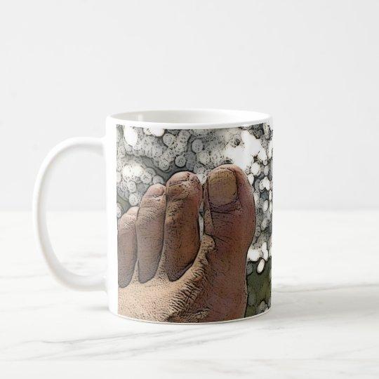en mis pies taza de café