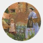 En un jardín en Cookham, Pinwell, familia del Pegatina Redonda