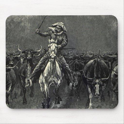 En una precipitación del vaquero del vintage de mousepad