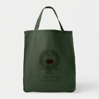 En vino es la verdad bolsas de mano