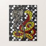 Encantador de serpiente (la serpiente y el robot) puzzle con fotos