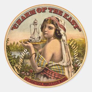 Encanto del anuncio del este 1872 del tabaco de pegatina redonda