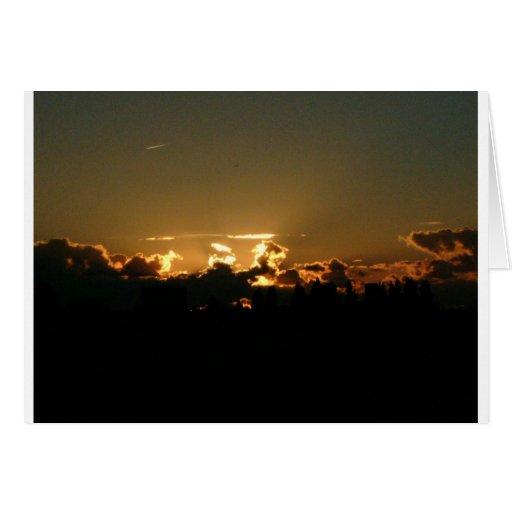 encima de puesta del sol felicitaciones