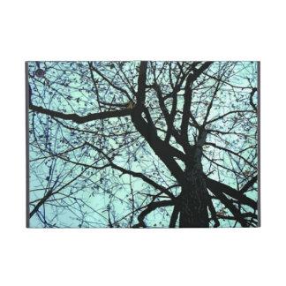 Encima del árbol iPad mini coberturas