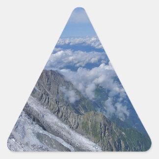 Encima del mundo - mirando abajo pegatina triangular