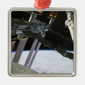 Endeavour's arm amidst International Space Stat Metal Ornament