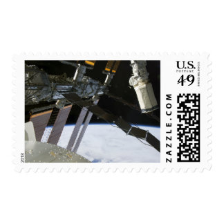 Endeavour's arm amidst International Space Stat Stamp