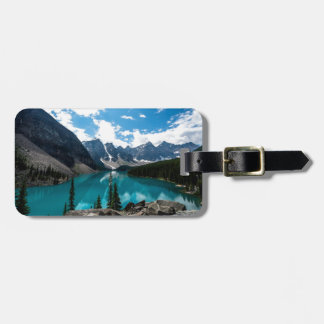 Endless blue skies above majestic mountains luggage tag