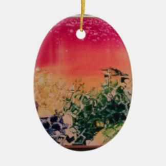 Energía en las piedras adorno navideño ovalado de cerámica