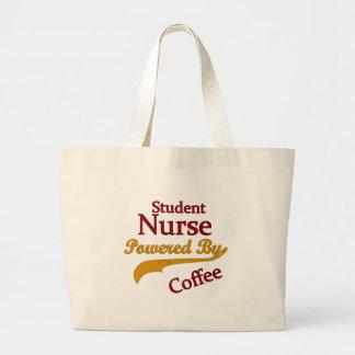 Enfermera de estudiante accionada por el café bolsas lienzo