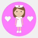 Enfermera linda del dibujo animado y rosa del etiquetas redondas
