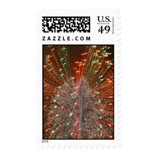 Enfoque de las luces de navidad del árbol de Live Franqueo
