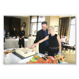 ENGAGEMENT PARTY: SHANE AND STEFFIE CUTTING CAKE! PHOTO