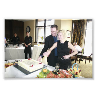 ENGAGEMENT PARTY: SHANE AND STEFFIE CUTTING CAKE! PHOTOGRAPH