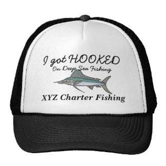 enganchado en el casquillo de la pesca gorra