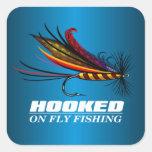 Enganchado en la pesca con mosca pegatinas cuadradases personalizadas