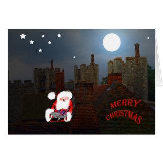 Engendre el navidad en el tejado con un presente tarjeta de felicitación