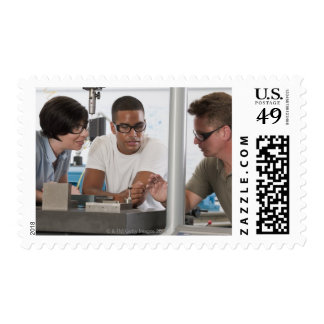 Engineering professor demonstrating a coordinate stamp