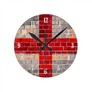 England flag on a brick wall round clock