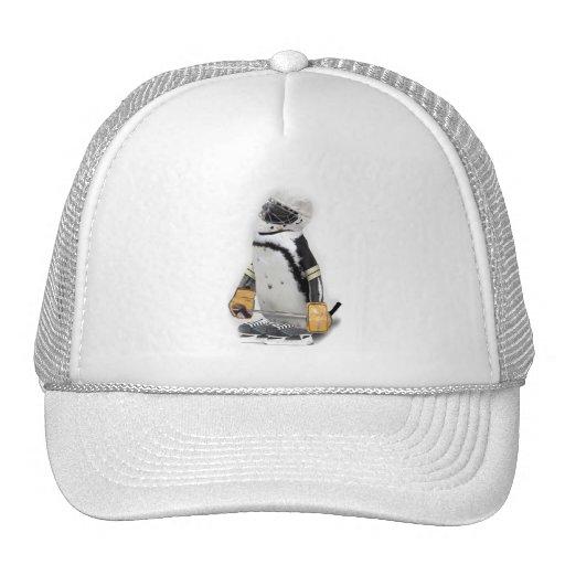 Engranaje del hockey del pequeño pingüino que gorro de camionero