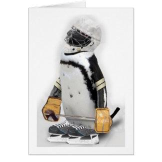 Engranaje del hockey del pequeño pingüino que tarjeta de felicitación