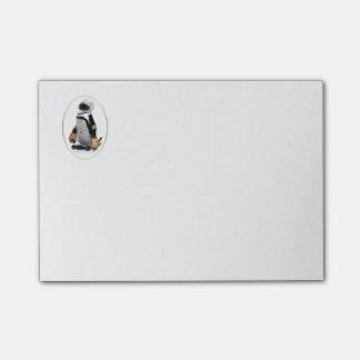 Engranaje del hockey del pingüino que lleva notas post-it®