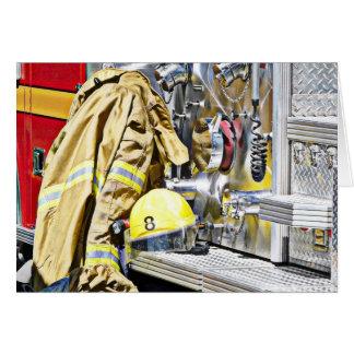 Engranaje y coche de bomberos del bombero de HDR Felicitación