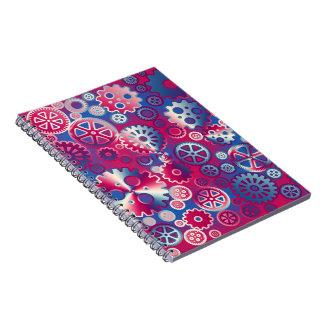 Engranajes metálicos coloridos cuadernos