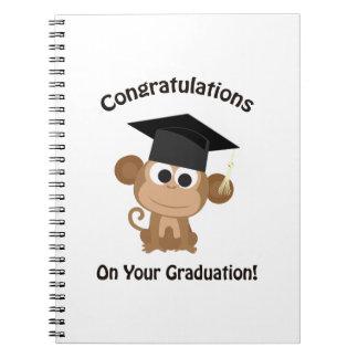 enhorabuena en su mono de la graduación spiral notebook
