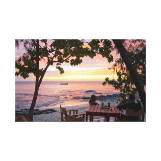 Enjoying a tropical sunset canvas print
