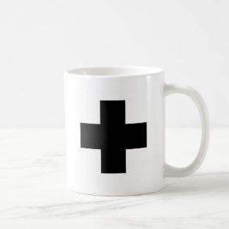 Ennegrezca la cruz de los primeros auxilios tazas de café