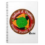 Ensalada y verduras contra la carne libreta espiral